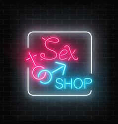 glowing neon sex shop street sign on dark brick vector image