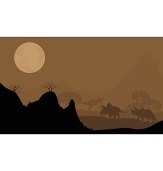 Silhouette of triceratops with moon at night vector