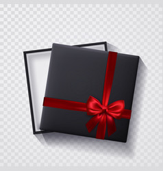 Open black empty gift box with red bow and ribbon vector