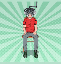 pop art man at clinic with optical phoropter vector image vector image