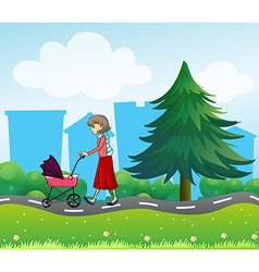 A girl with a baby stroller along the road vector