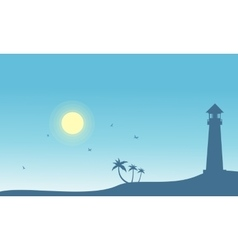 Silhouette of lighthouse and palm scenery vector