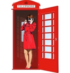 girl in an English phone booth vector image