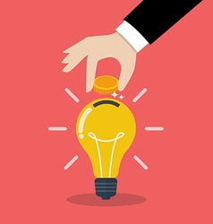 Hand inserting coin in light bulb vector