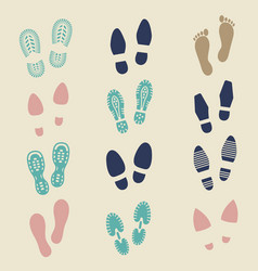 Colorful footprints - female male and sport shoe vector