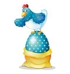 A hen above a big easter egg vector image