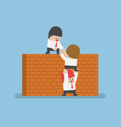 businessman help his friend to cross the brick vector image vector image