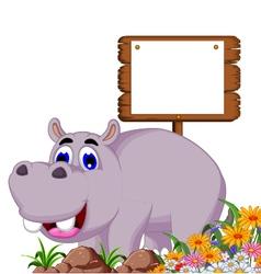 funny hippo cartoon with blank board vector image vector image