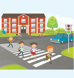 school children cross road on pedestrian crossing vector image vector image