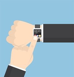 Businessman hand using smartwatch on his wrist vector image