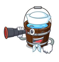 Sailor with binocular wooden bucket mascot cartoon vector