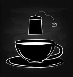 Black and white drawing of a cup and tea bag vector