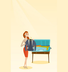 Caucasian woman packing clothes in a suitcase vector