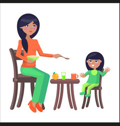 mother feeds her little daughter sitting at table vector image