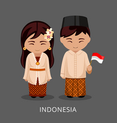 Indonesians in national dress with a flag vector