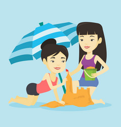 two friends building sandcastle on beach vector image vector image