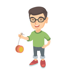 Caucasian boy in glasses playing with yo-yo vector