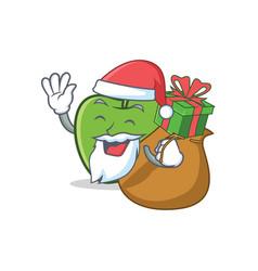 Santa green apple character cartoon with gift vector