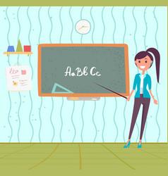 teacher teaching abc blackboard in classroom vector image