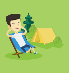man sitting in folding chair in the camp vector image
