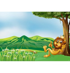 A lion king relaxing at the hilltop vector image