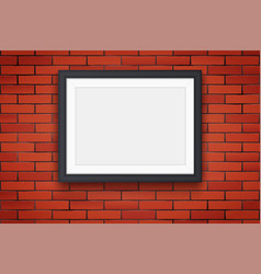Red brick wall with picture frame vector
