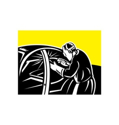 Welder with welding torch working on car vector image vector image