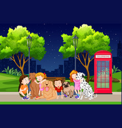 Group of children and dogs in park vector