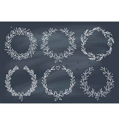 Set of winter wreaths on blackboard vector image