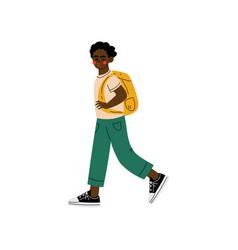 African american boy walking to school student vector