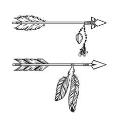 Tribal arrows with pendants vector