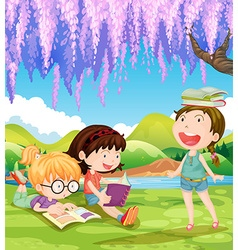 Children reading books under the tree vector
