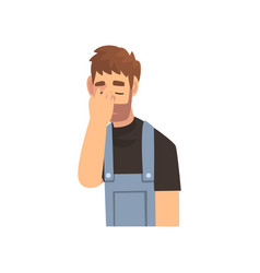 Young bearded man in overalls covering his face vector