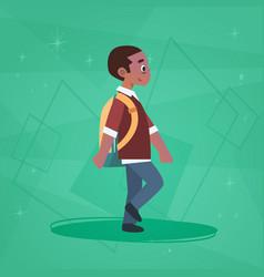African american pupil walking school boy vector