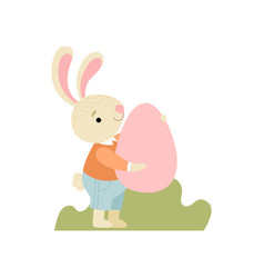 cute bunny in clothes holding pink egg happy vector image