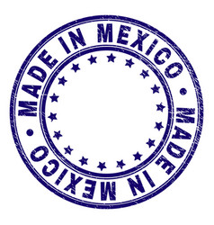 Grunge textured made in mexico round stamp seal vector