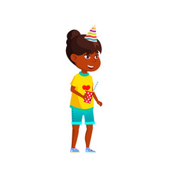 Happy african girl wearing festive hat and holding vector