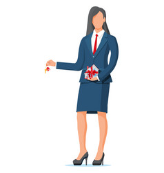 Businesswoman holding house building and key vector