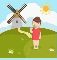 little girl sniffs a flower little girl sniffs a vector image