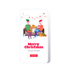 senior man in elf hat giving present gift box to vector image