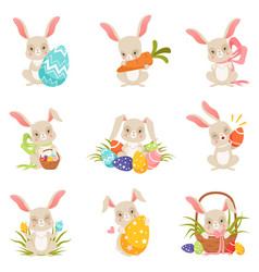 cute cartoon bunnies holding colored eggs set vector image