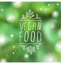 Vegan food - product label on blurred background vector image