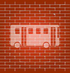 Bus simple sign whitish icon on brick vector