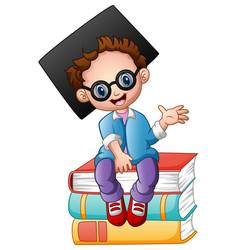 graduation boy sitting on piles of books vector image