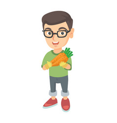 Caucasian boy in glasses holding fresh carrot vector