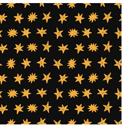 Golden stars seamless pattern on black background vector