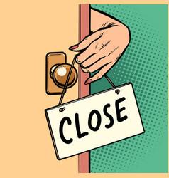 close woman hand hangs a sign on door vector image