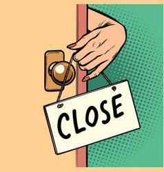 Close woman hand hangs a sign on the door vector