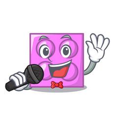 Singing toy brick mascot cartoon vector