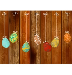 Easter eggs on a wooden wall EPS8 vector